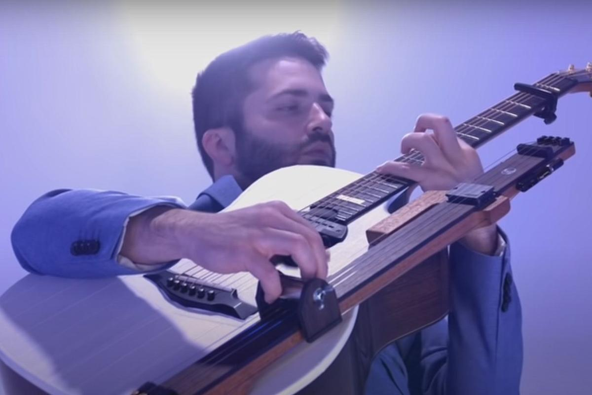 Luca Stricagnoli with the production-ready Reversed Slide Neck mounted to a host acoustic guitar
