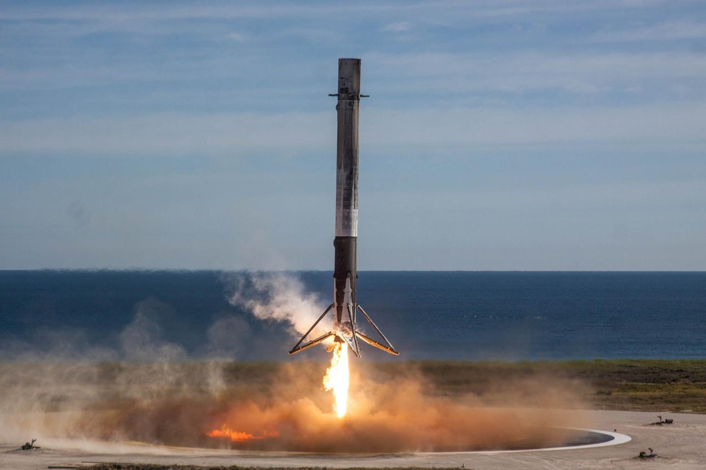 Falcon 9 booster lands after launching the Dragon spacecraft into space