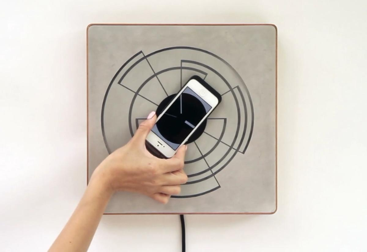 Spira allows your smartphone to be used as a wall clock while it's being inductively charged