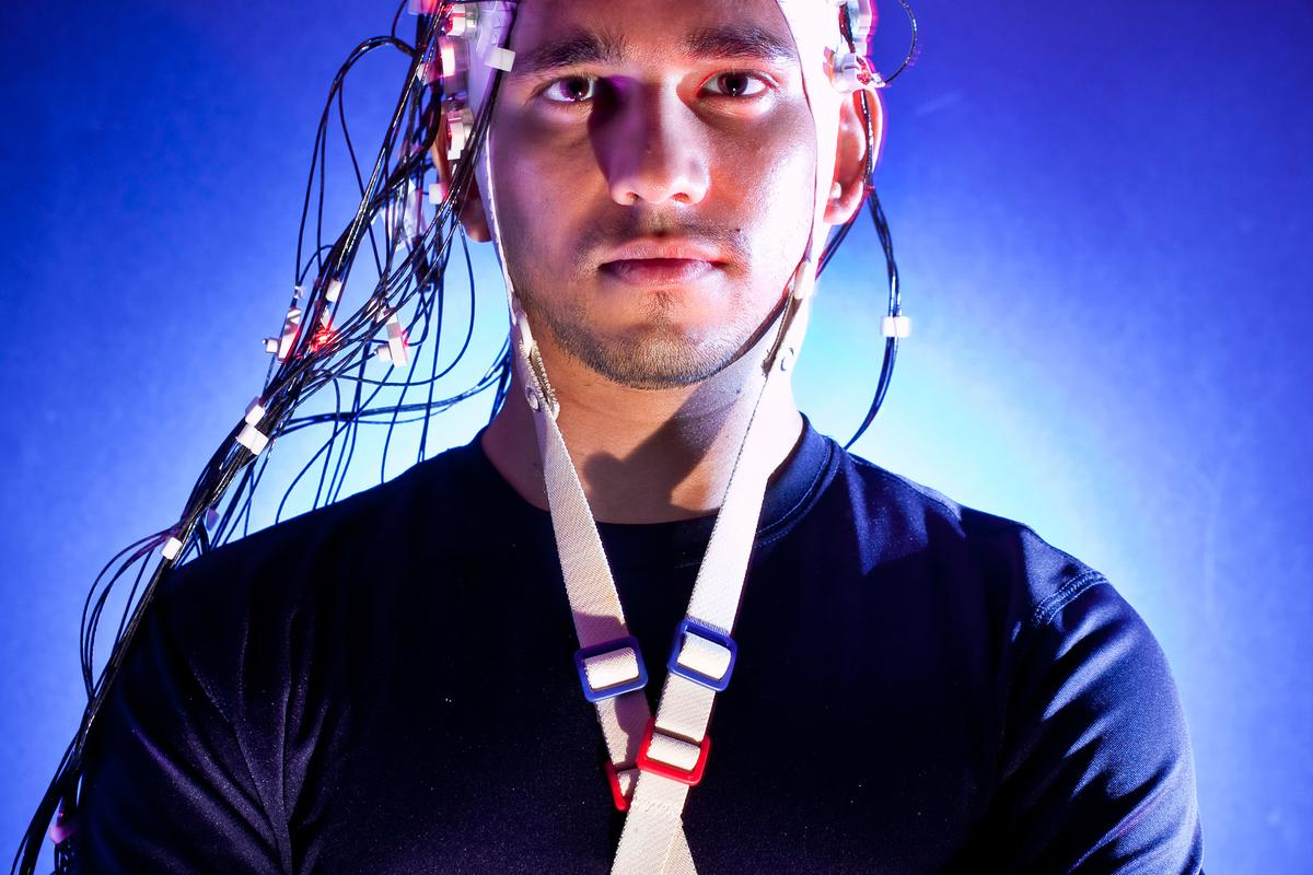 Harsha Agashe, a Ph.D. student in Contreras-Vidal's lab at UMD wears the Brain Cap, a non-invasive, sensor-lined cap (Image: John Consoli, University of Maryland)