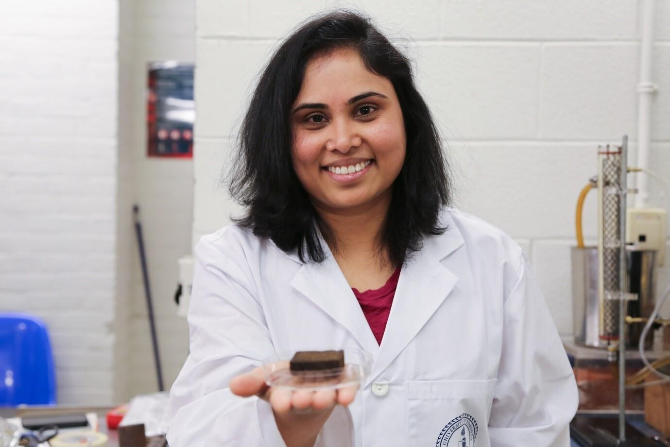 Dr. Pavani Cherukupally with the sponge, in her lab