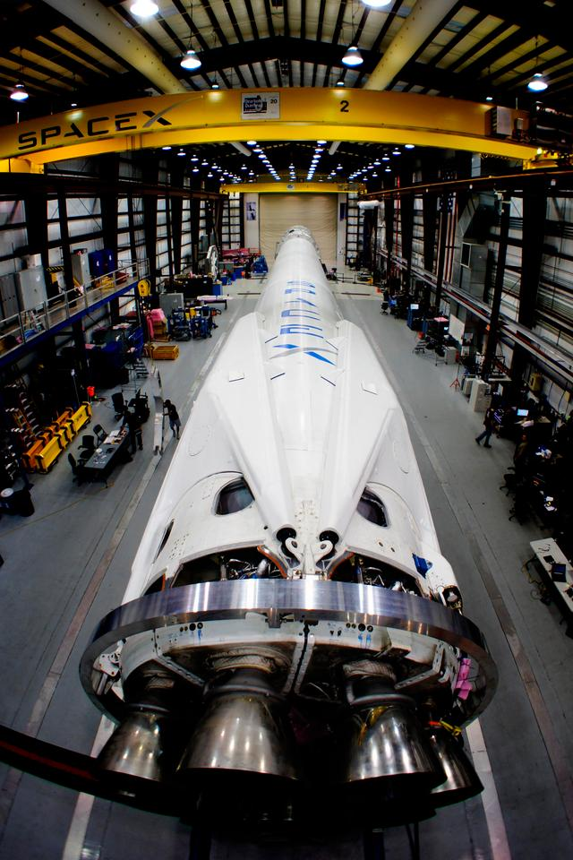 Falcon 9 booster with folded landing legs