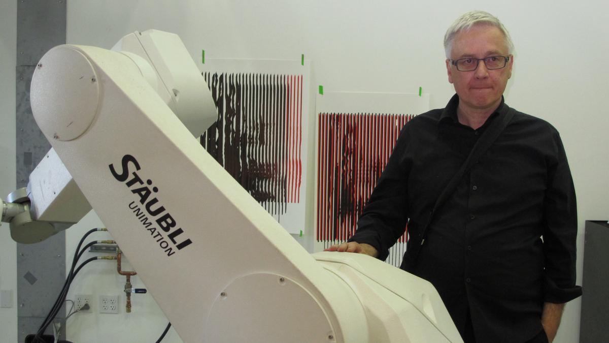 "Studio professor Peter Testa with one of the Staübli ""Unimation"" robot arms (Photo: Phyllis Richardson)"