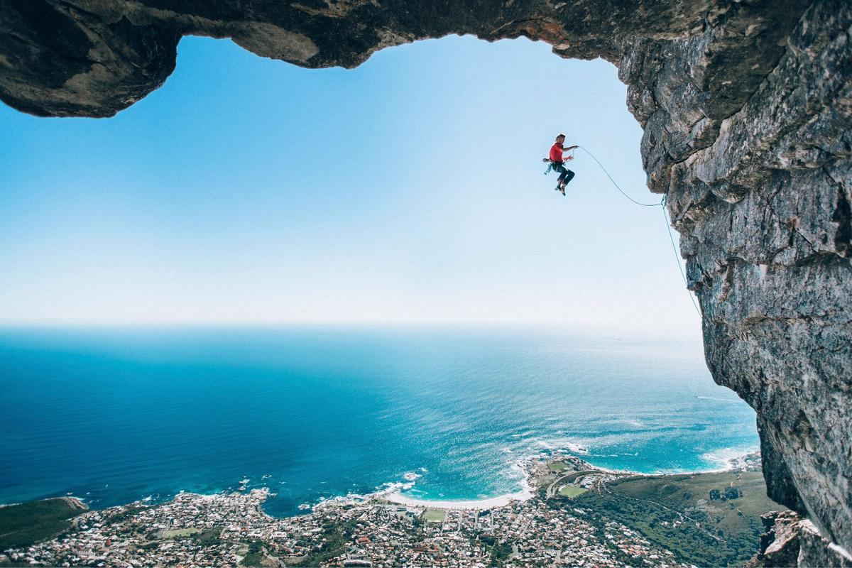 """Photographer Micky Wiswedel snapped climber Jamie Smith airborne above Cape Town to win the """"Wings"""" category of theRed Bull Illume Image Quest in2016"""