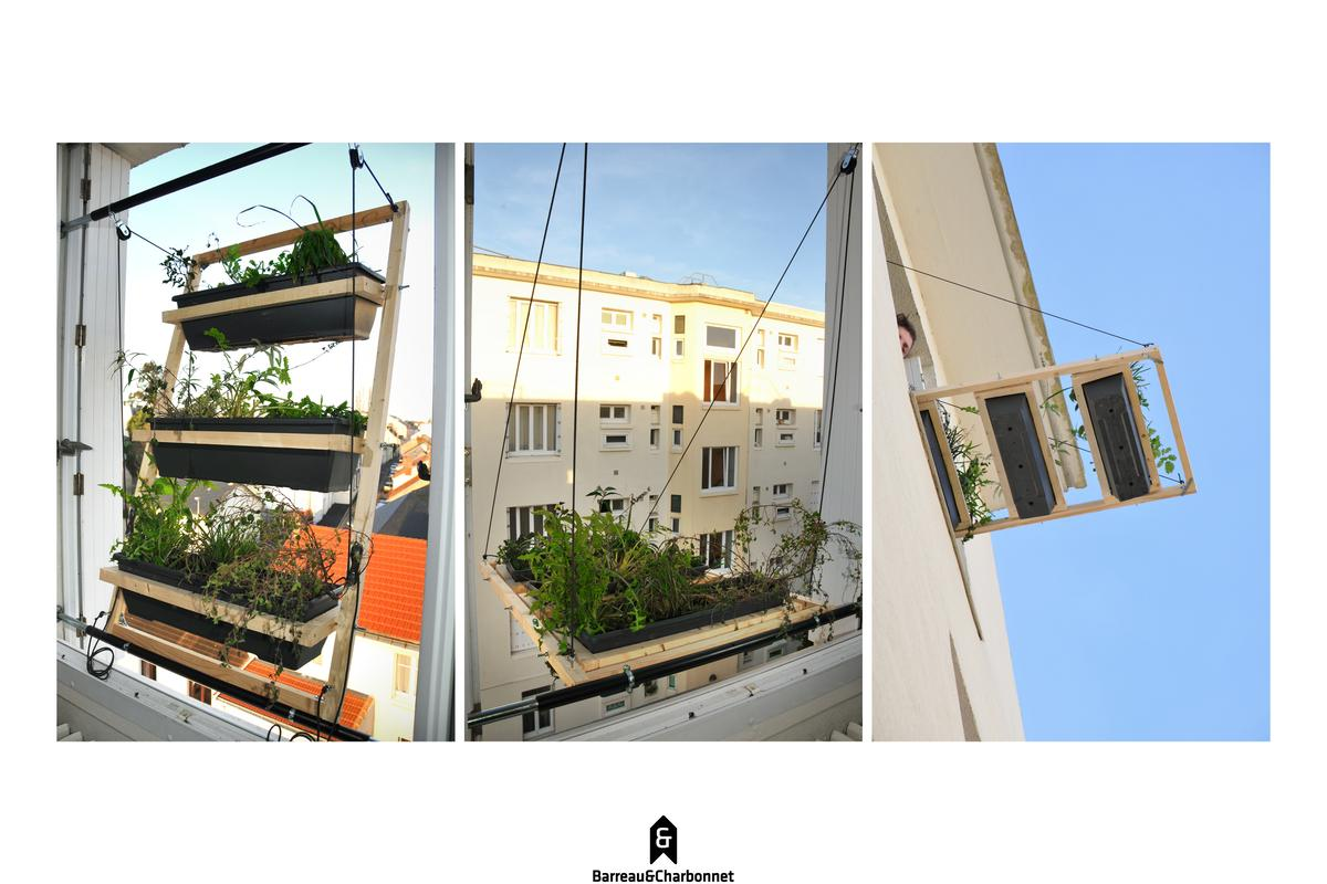 Designers Barreau & Charbonnet have created a hanging window garden solution named Volet végétal with plant containers that are raised and lowered on a pulley system rigged up to the outside of an apartment window