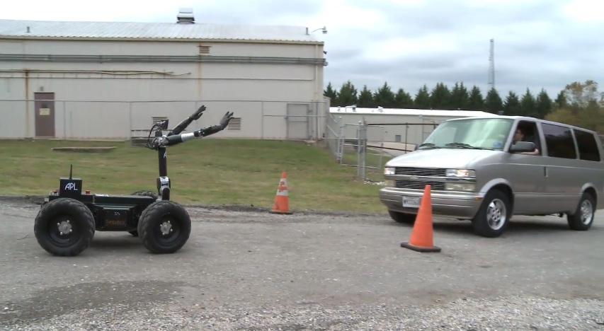 Johns Hopkins University's Bimanual Dexterous Robotics Platform stops a vehicle at a mock checkpoint