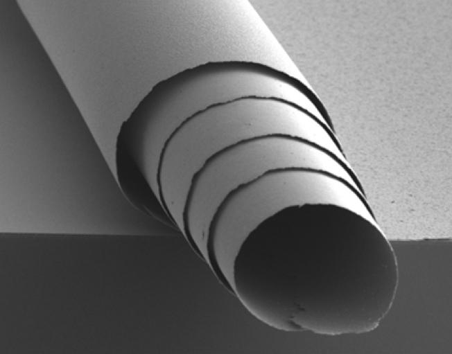 A rolled film of the material – the roll is about one tenth the diameter of a human hair