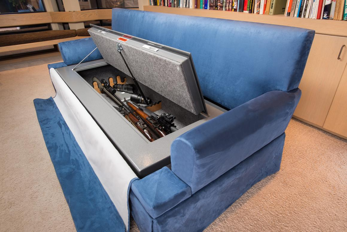 Besides offering a comfy place to sit and watch TV, the CouchBunker conceals a large gun safe and provides some handheld shields in the form of bullet-resistant cushions