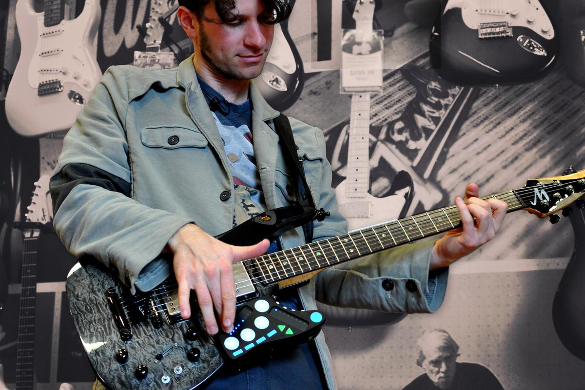 The Guitar Wing class-compliant MIDI controller wirelessly connects to a computer over Bluetooth LE via an included USB MIDI dongle