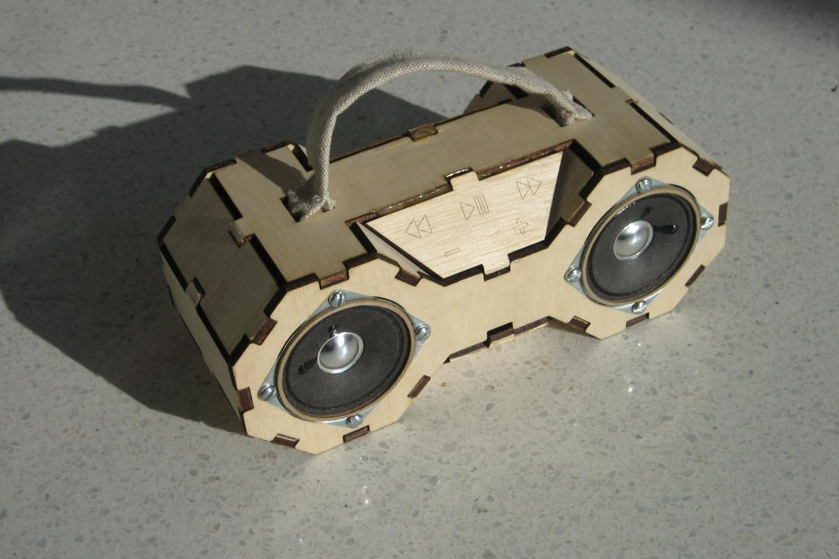 The various laser-cut wooden panels of Matt Keeler's Fab Boombox snap together to form the outer shell for a digital music player with stereo speakers and a touch-sensitive UI