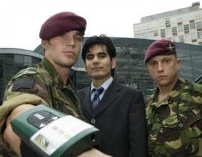 Amin Ismail and the device, with Captain Ollie Jedrej and Lance Corporal Dave Walker, from the 4th Battalion: Parachute Regiment.