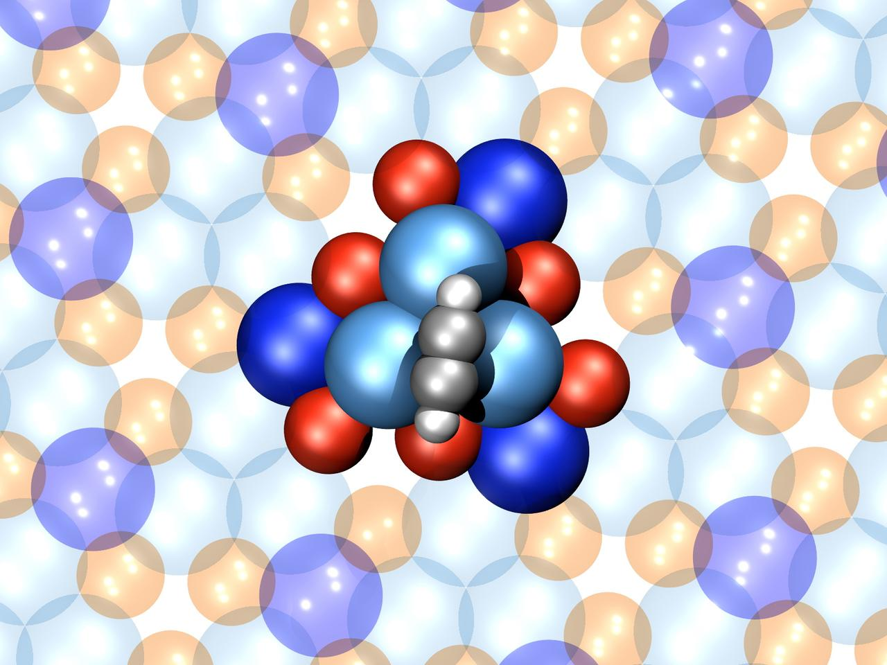 A model of the nano motor – the stator is made up of six palladium atoms (blue) and six gallium atoms (red), with a four-atom rotor made up of a four-atom acetylene molecule (gray)