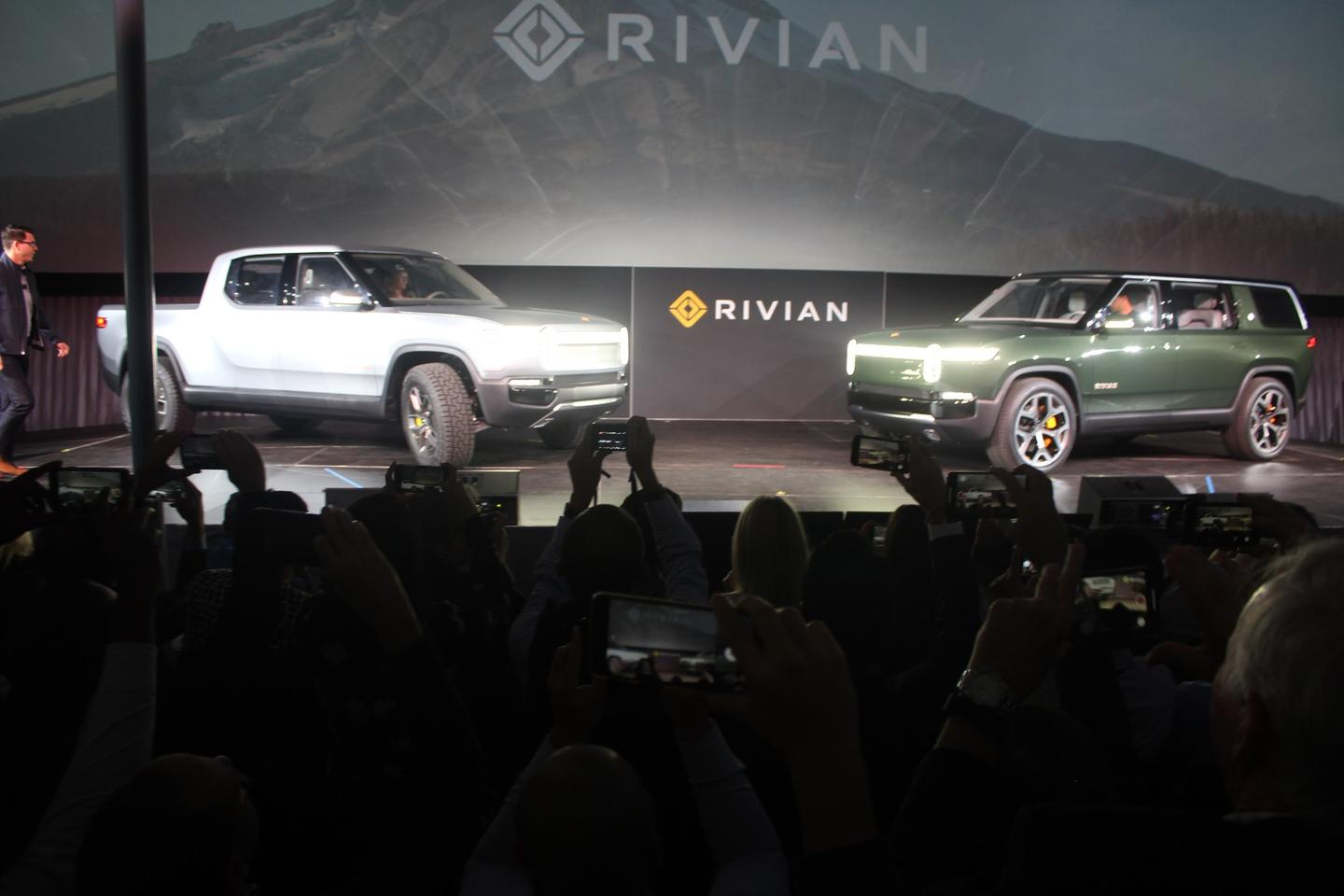 The Rivian R1T (left) and R1S on display at the Los Angeles Auto Show