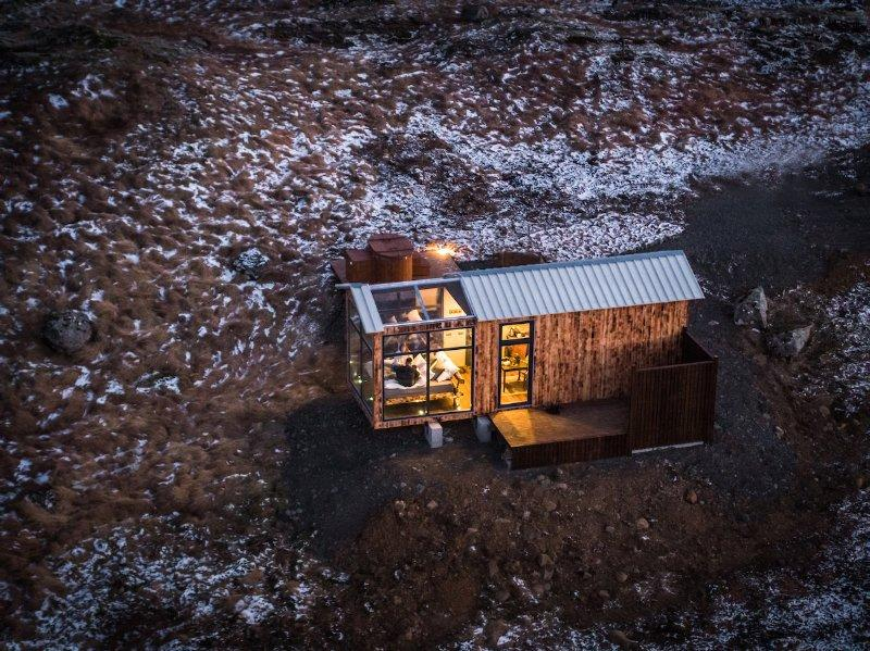 The Panorama Glass Lodge is a standalone cabin on the water's edge around 30 minutes' drive away from Reykjavík, iceland's capital