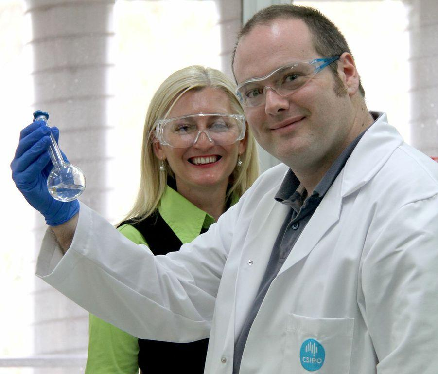 Larissa Bright and Dr. Mark York in the lab with a flask of UV filters (Photo: CSIRO)