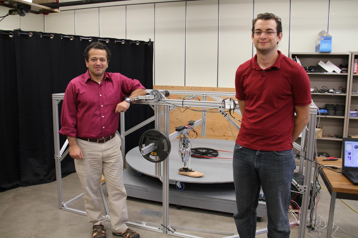 Prof. Mo Rastgaar (left) and PhD student Evandro Ficanha, with the leg and its testing rig