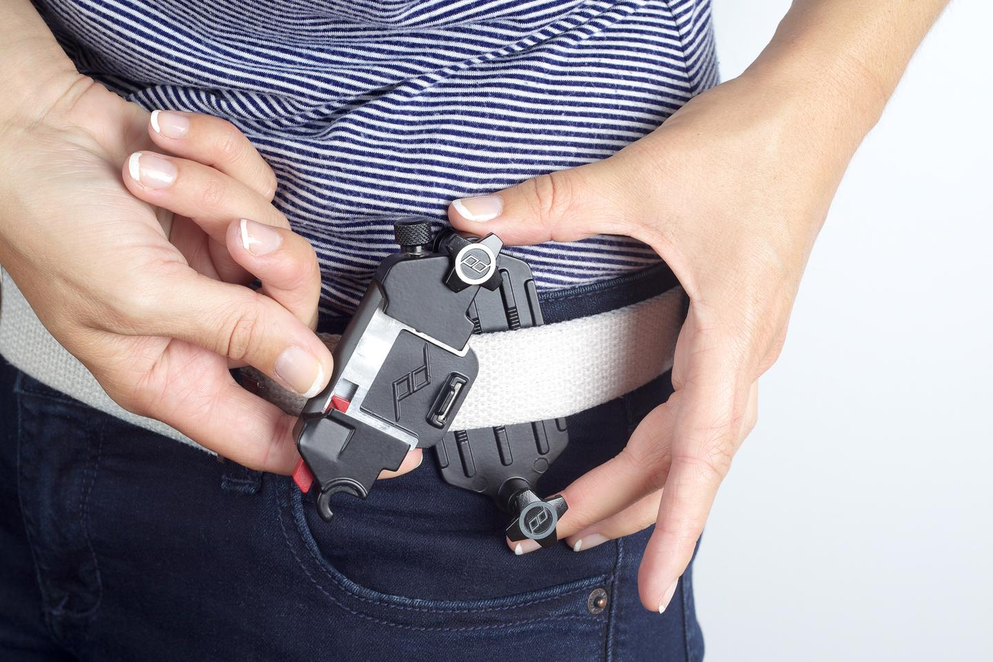 The Capture Camera Clip is clamped to a belt and then secured in place with two adjustable, low profile screws