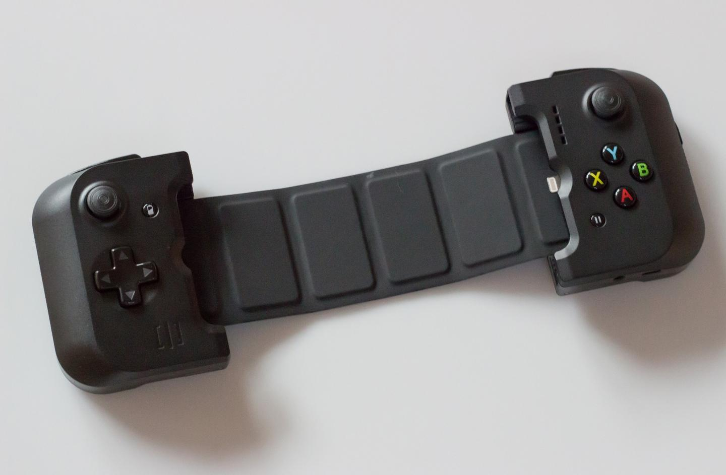 Like the larger version for iPad mini, Gamevice for iPhone has a retractable strap on the back