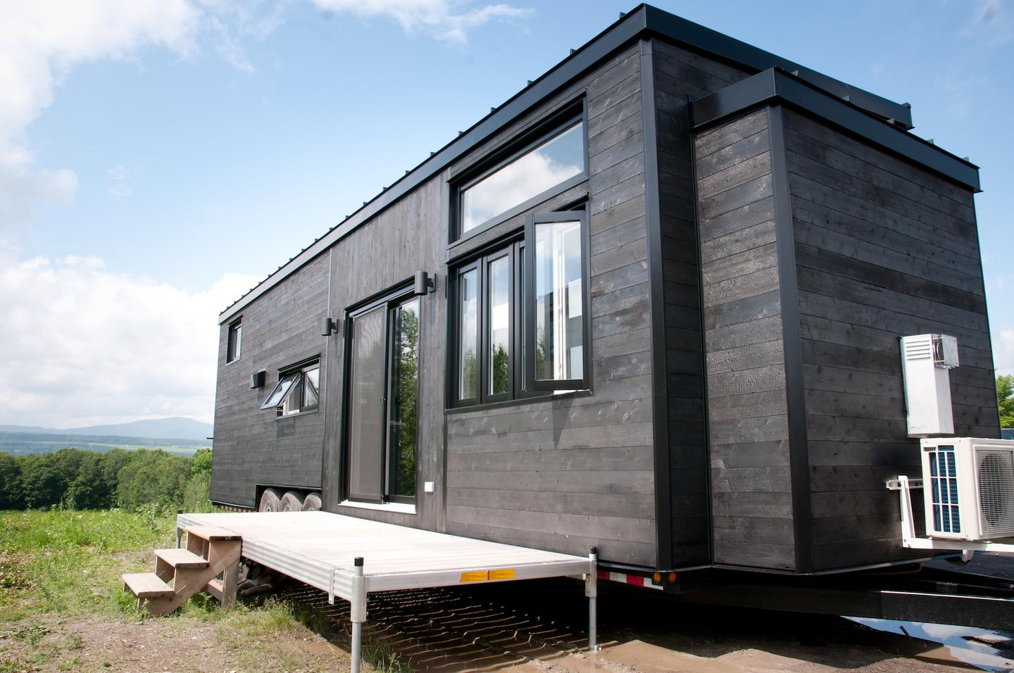 The Baobab tiny house is clad in wood that's been treated using the distinctive Japanese Shou Sugi Ban method of charring wood to preserve it