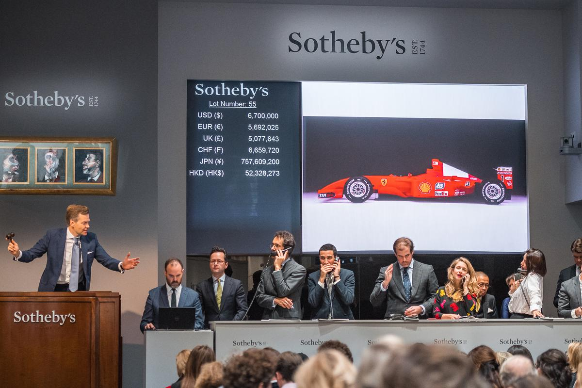 Michael Schumacher's championship-winning Ferrari F2001 is sold before a packed Manhattan auction room at Sotheby's Contemporary Art Evening Sale, 16 November in New York