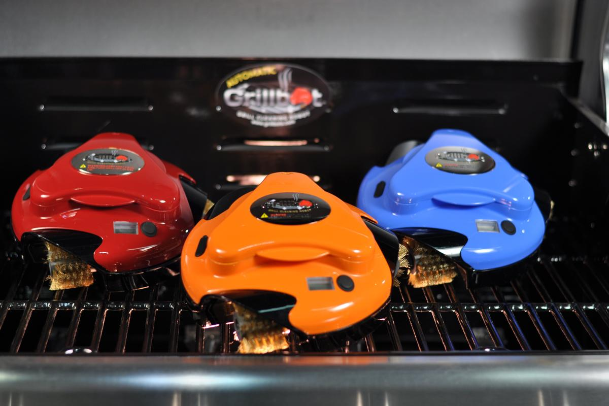 The Grillbot is a cute, single button operated bot that perches on your grill and lives to clean