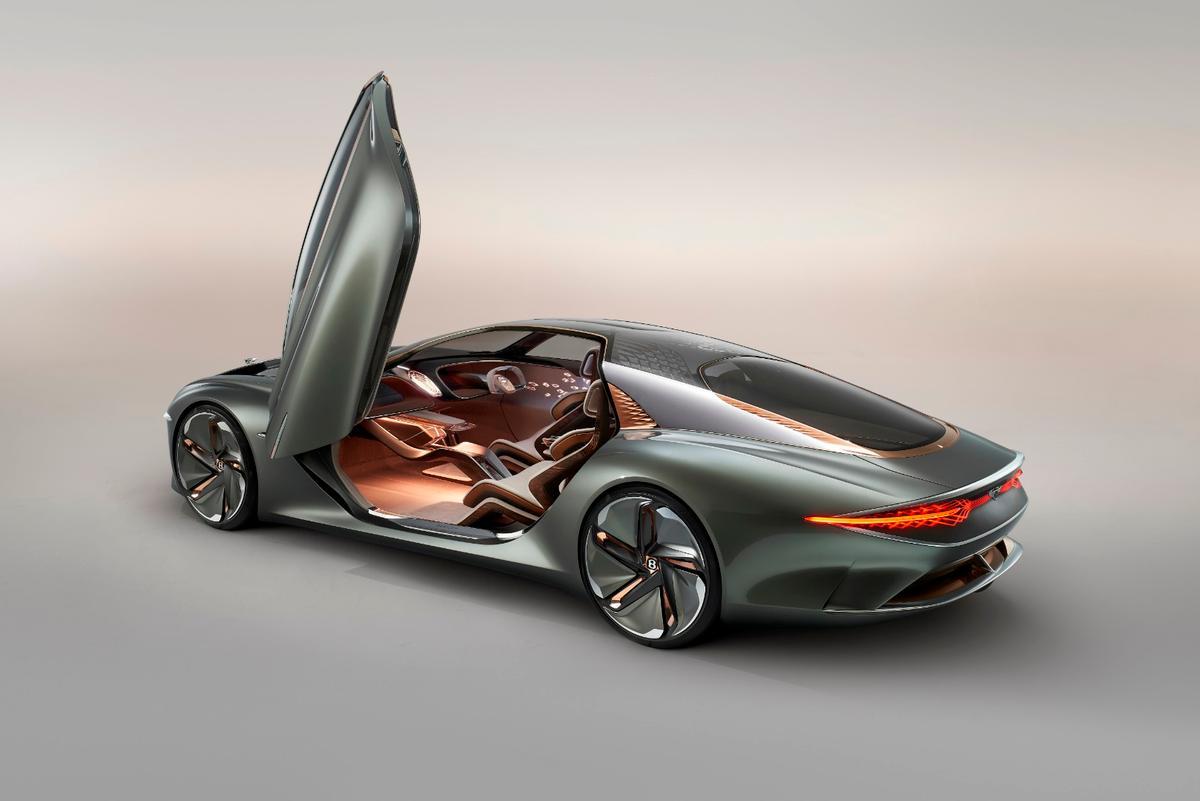 The Bentley EXP 100 GT's massive doors rise to almost 10 feet when open