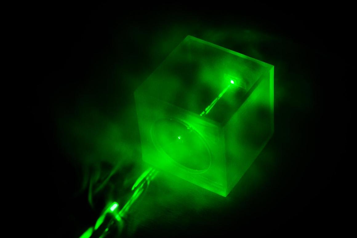 A Raman laser shines on a special chip, which traps gas molecules