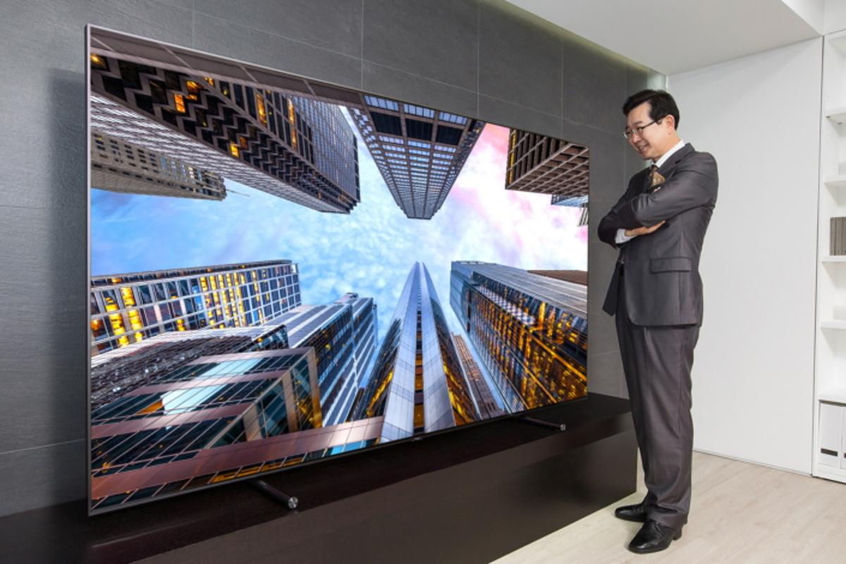 A Samsung executive enjoys the 88-inch QLED TV
