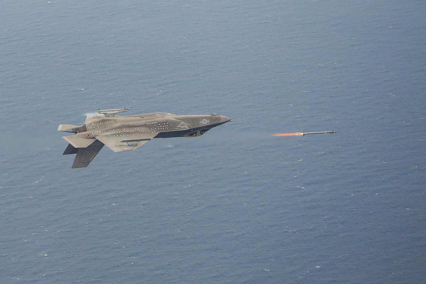 An inverted F-35C launches anAIM-9X missile during a live fire test event