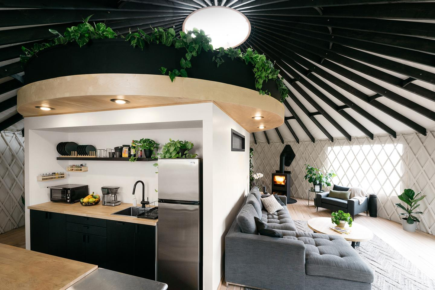 The interior has been personally adapted by the couple to include a central core unit that houses the home's modern kitchen