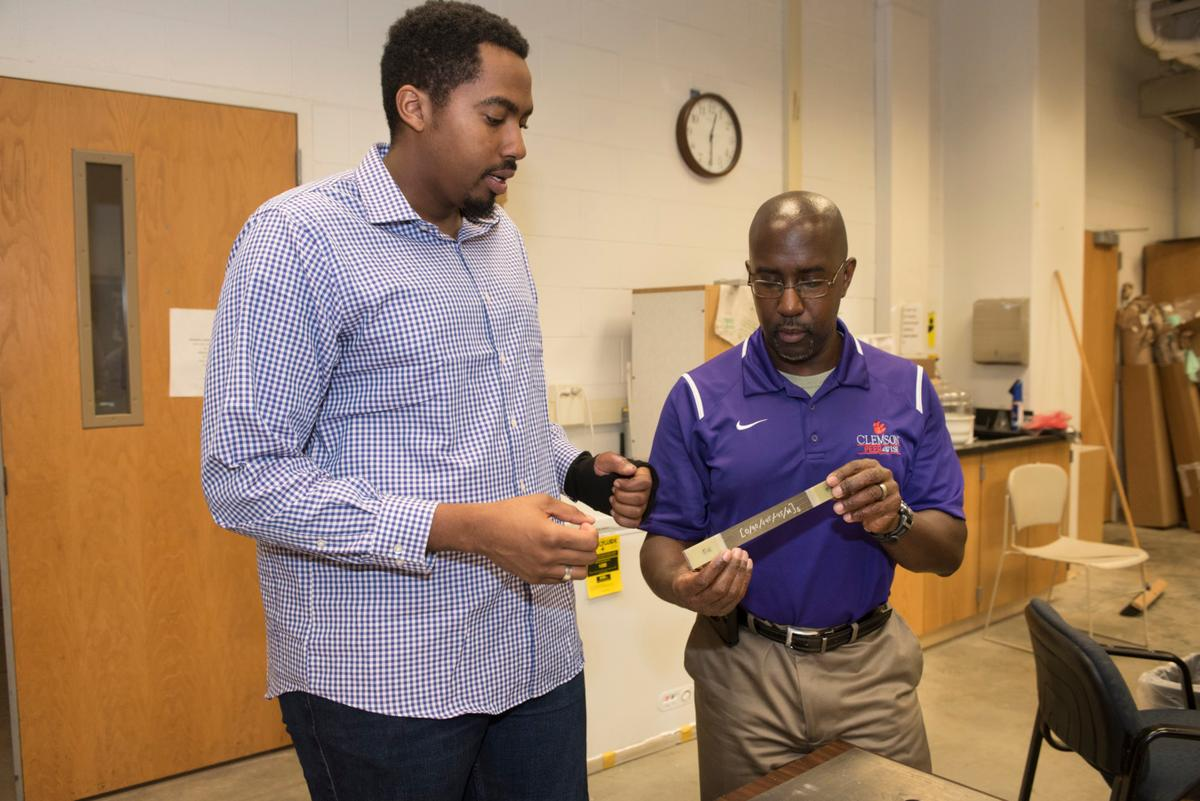 Clemson University researchers with a sample of their new smart material, which could act as damage sensors for vehicles
