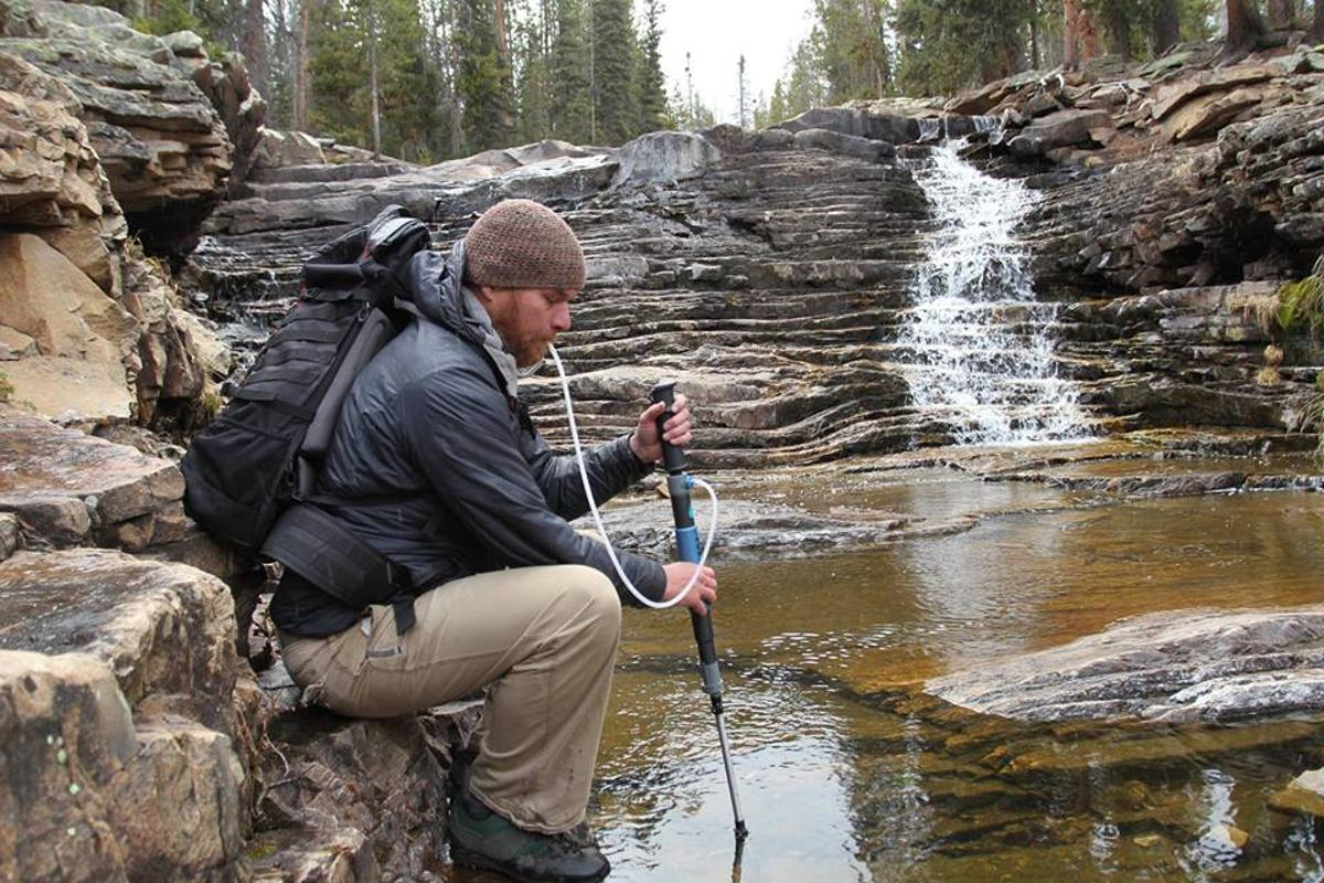The PurTrek trekking pole/water purifier in use