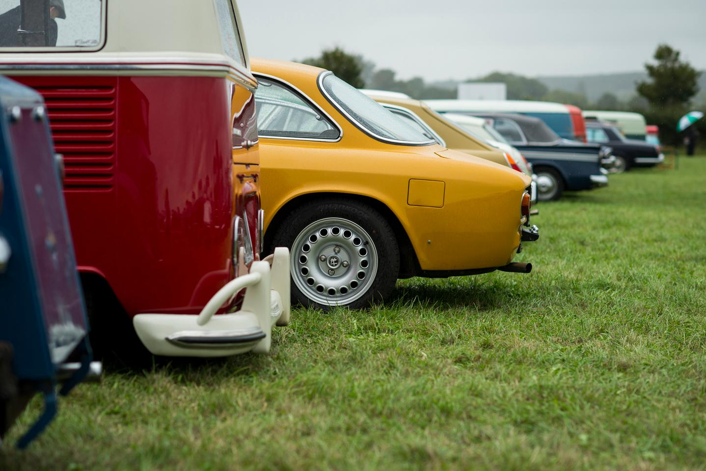 Alfa-Romeos and Volkswagens on the lawn at Goodwood
