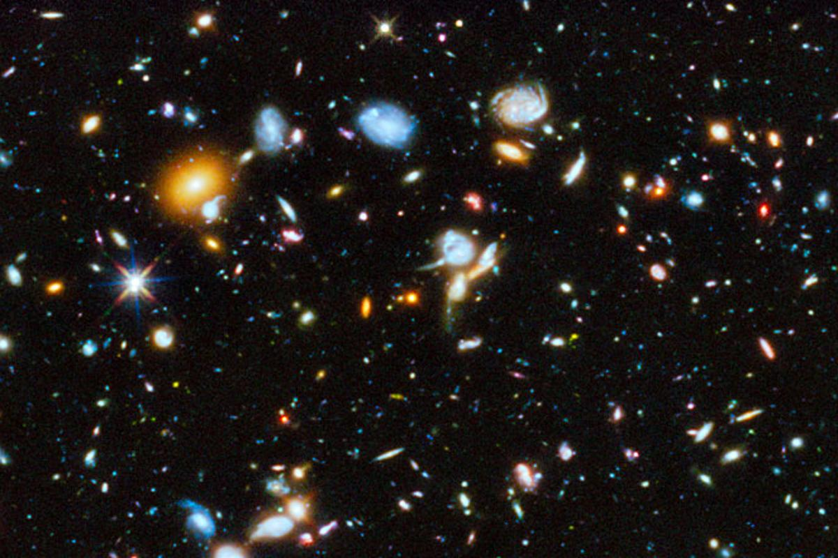 The Hubble Space Telescope has taken a long-exposure picture of space in the ultraviolet, revealing newly formed stars and galaxies (Image: NASA/ESA)