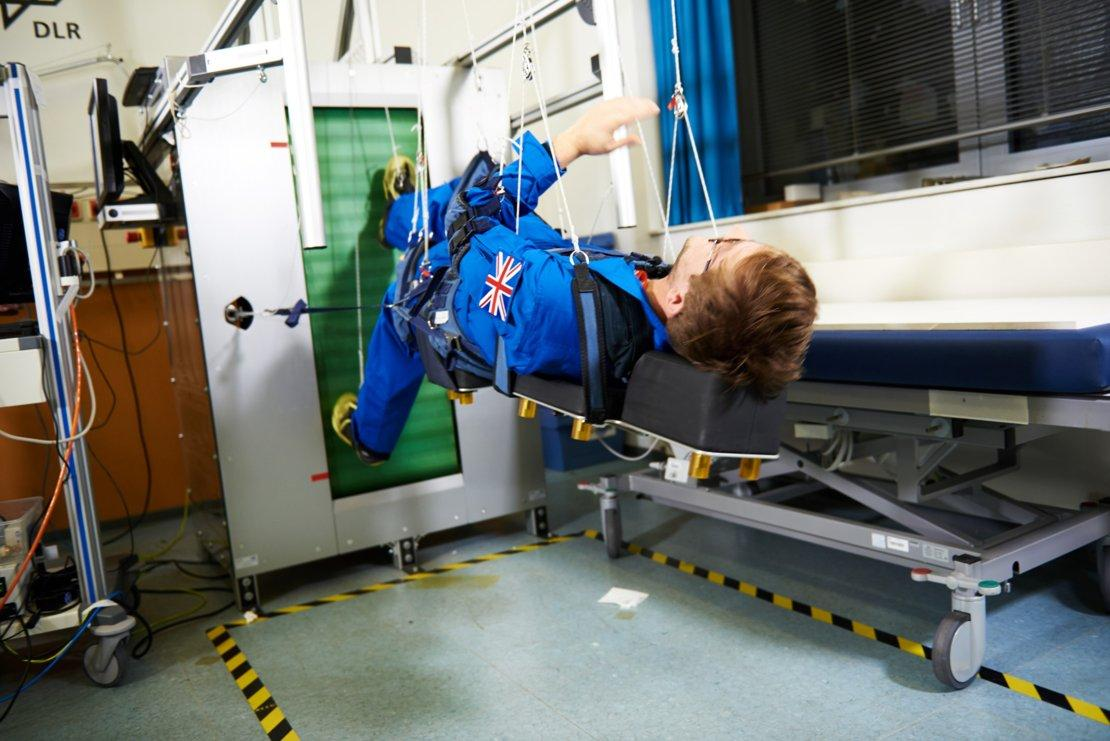 Steffan Powell of theBBC tries out the space treadmill