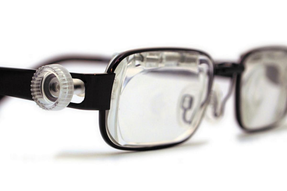 The Eyejusters adjustable glasses with the adjustment tool in place
