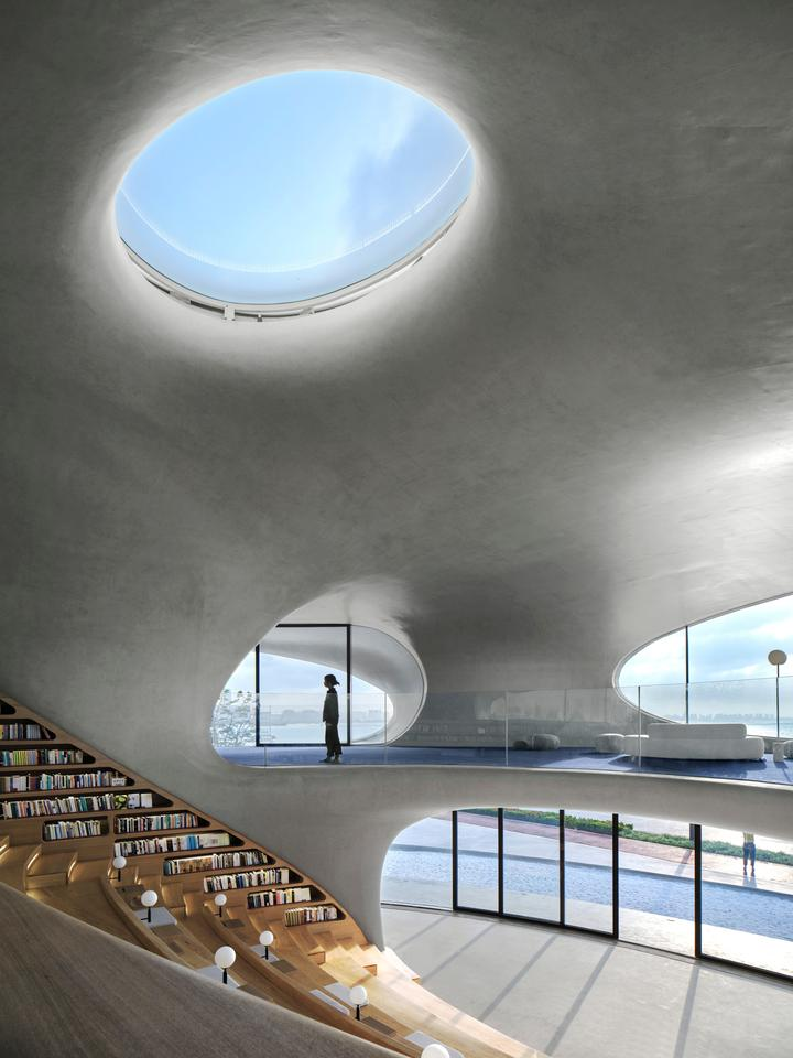 Cloudscape of Haikou's interior is naturally illuminated by strategically placed holes in the facade and ceiling