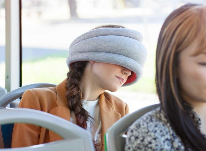 The Ostrich Pillow Light can be used by commuters seeking to grab 40 winks on the bus