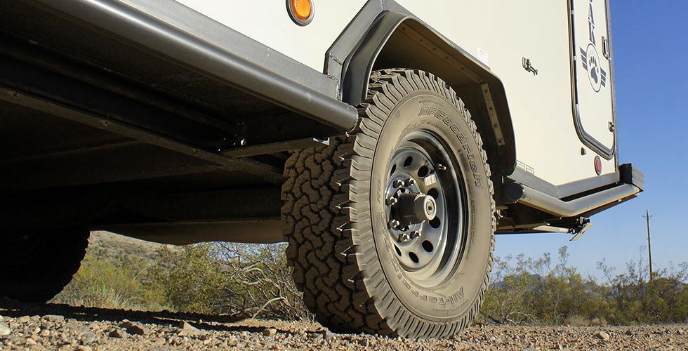 The ADAK trailer has all-terrain tires and eight-lug wheels