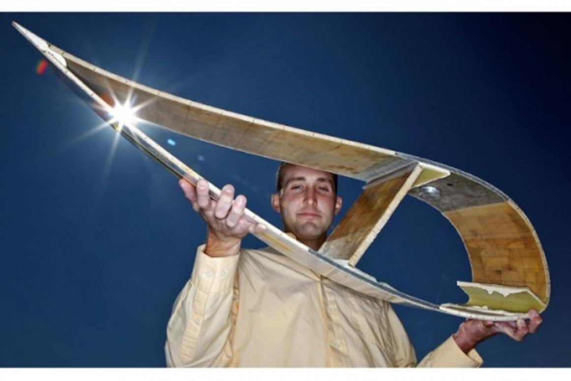 Purdue University doctoral student Jonathan White holds a cross-section of a wind turbine blade, like the one used in research to improve the efficiency of turbines