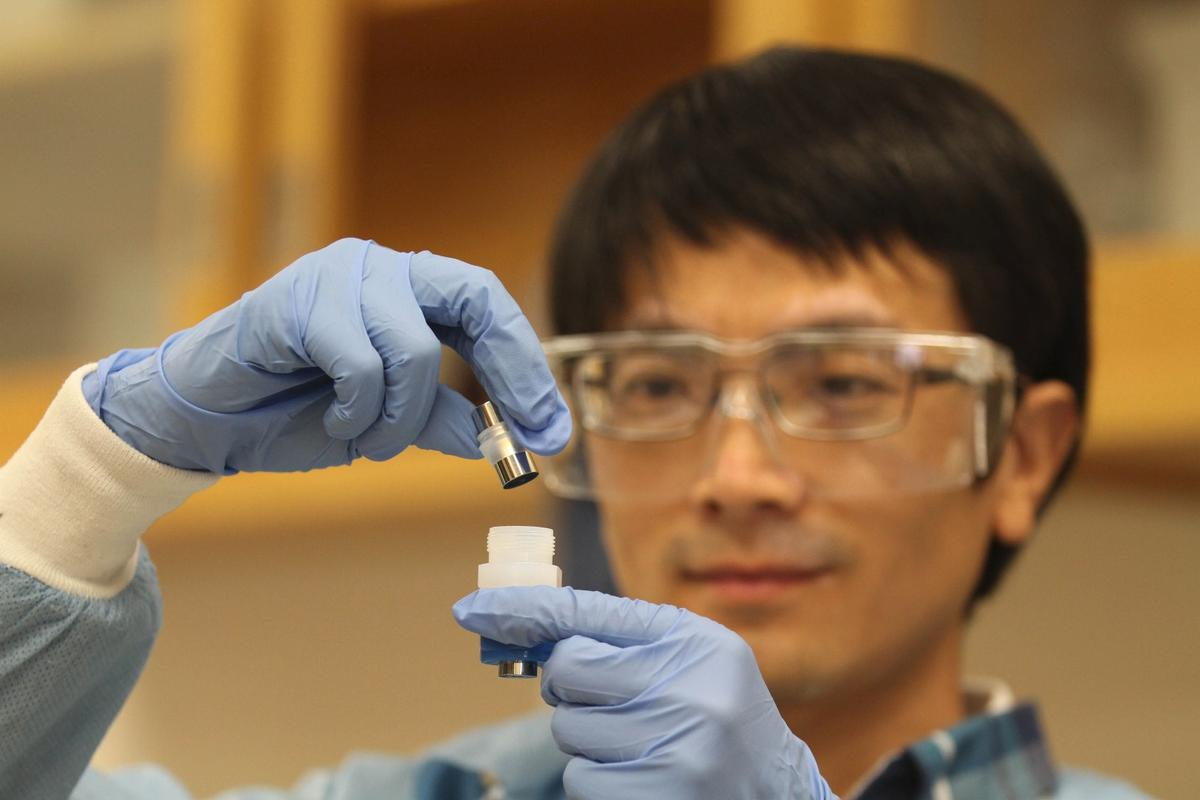 LLNL postdoc Jianchao Ye with the improved lithium ion battery