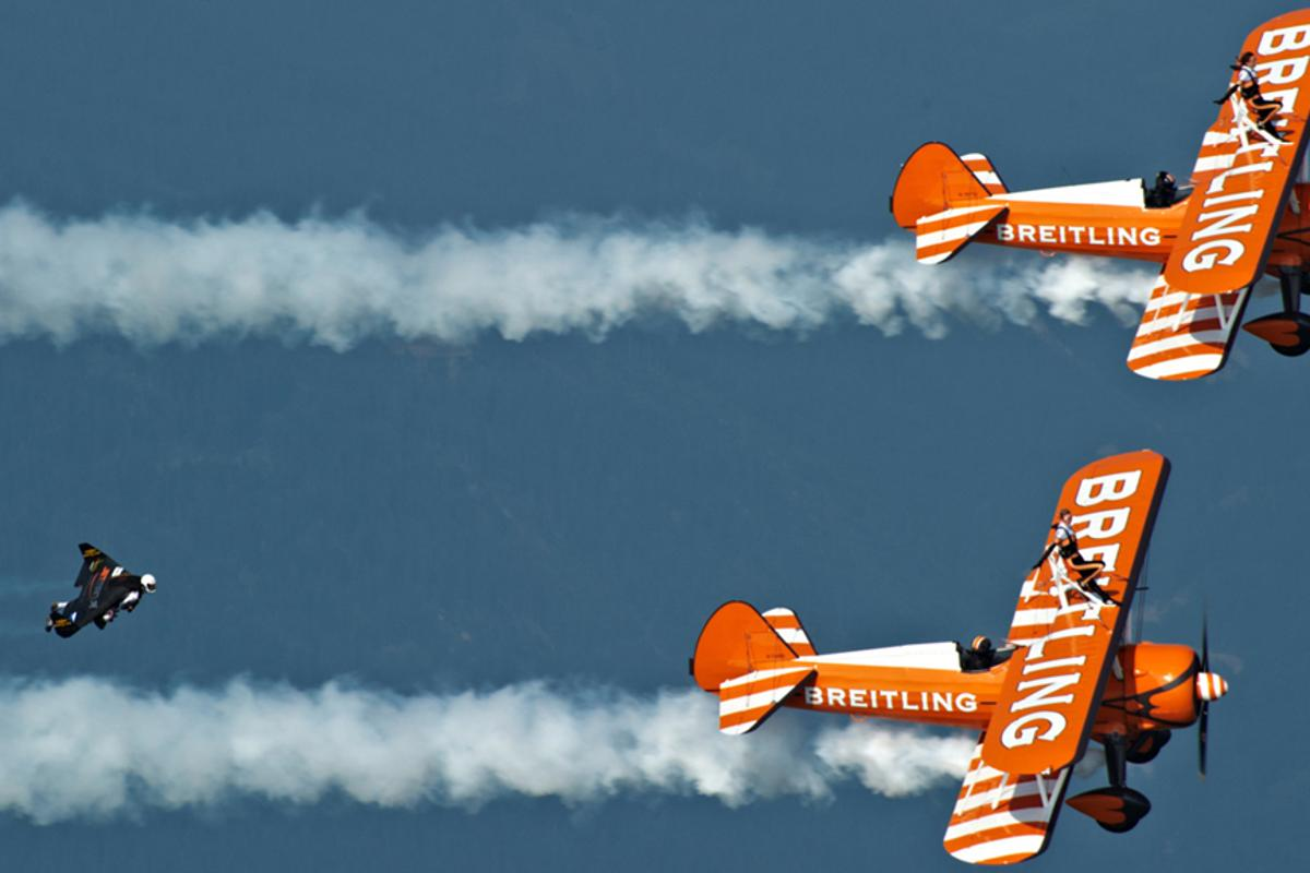 """Yves """"Jetman"""" Rossy flies in formation with the Breitling Wingwalkers"""