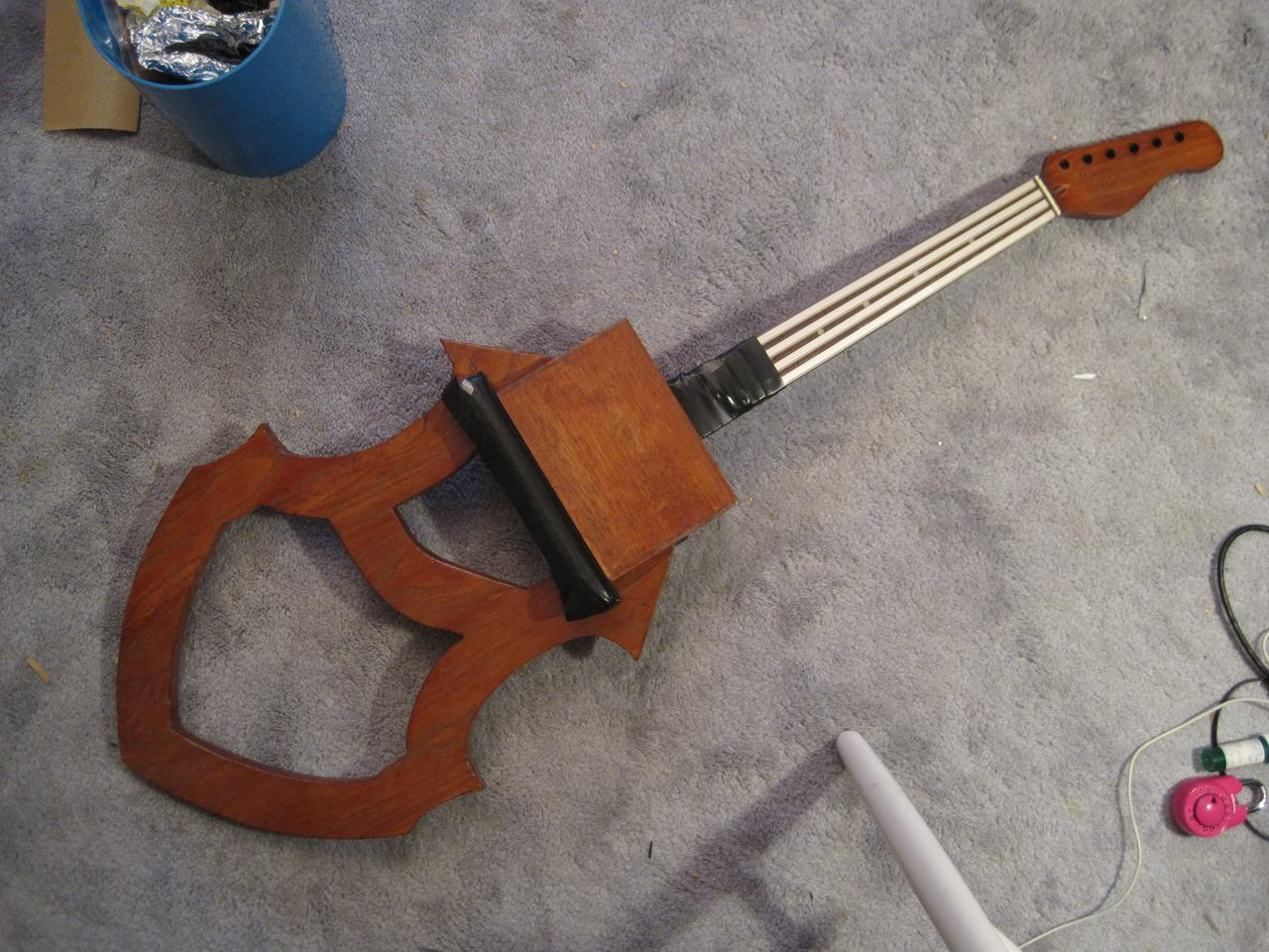 Early prototype of the Magnetic Cello, with four resistive ribbons on the neck