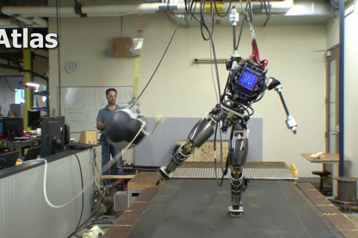 An incomplete version of the ATLAS robot maintains its balance even when hit with a 20 lb ball
