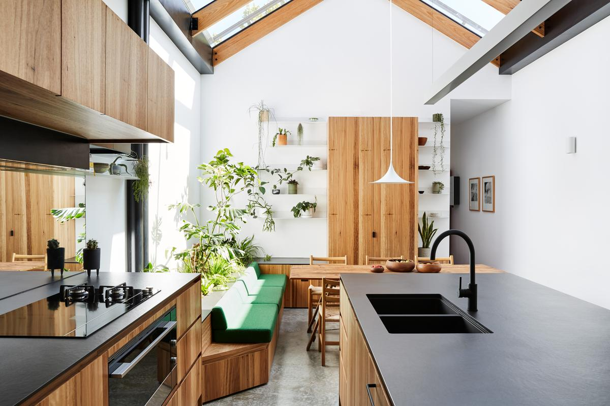 "Newry House turns what Austin Maynard Architects describes as ""one of the smallest, darkest, bleakest dining rooms to ever exist"" into a light-filled center of the family home"
