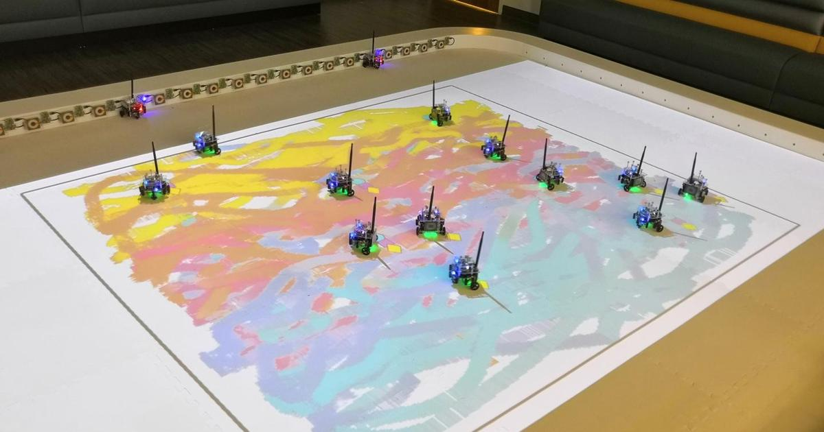 Tiny robots work together to paint pictures