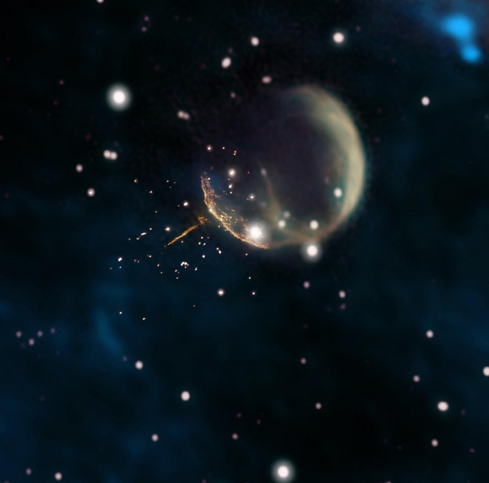 "The CTB 1 supernova remnant, visible here as a ""bubble."" The speeding pulsar is a tiny dot at the end of the orange trail of magnetic energy to the lower left of the bubble"