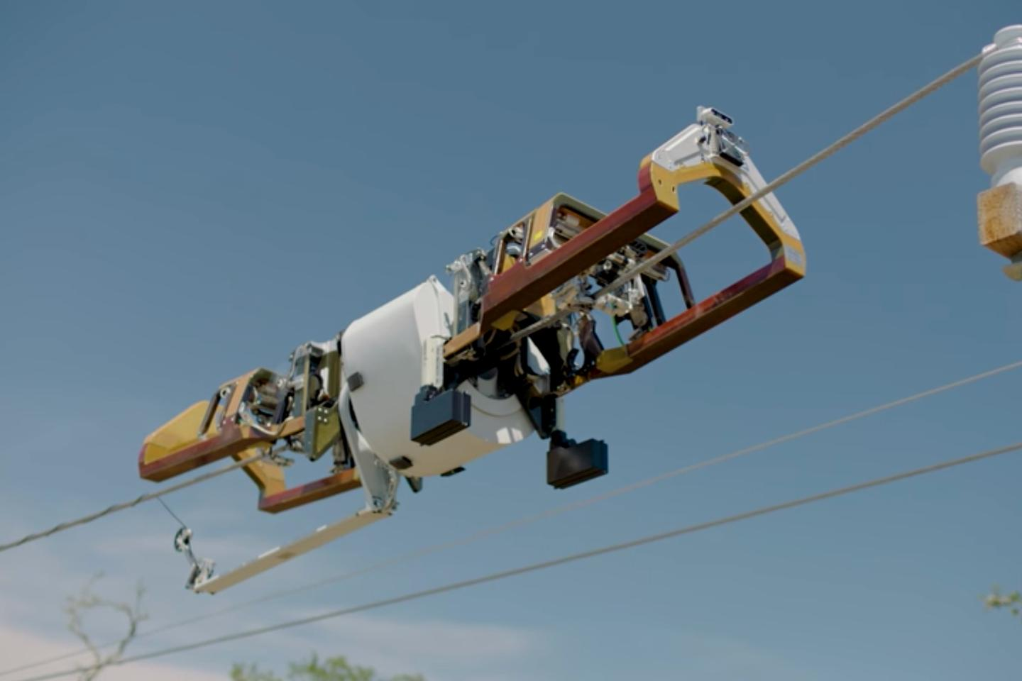 The Bombyx robot's main body remains level to the ground, while an internal mechanism winds a payload of fiber optic cable around the power line