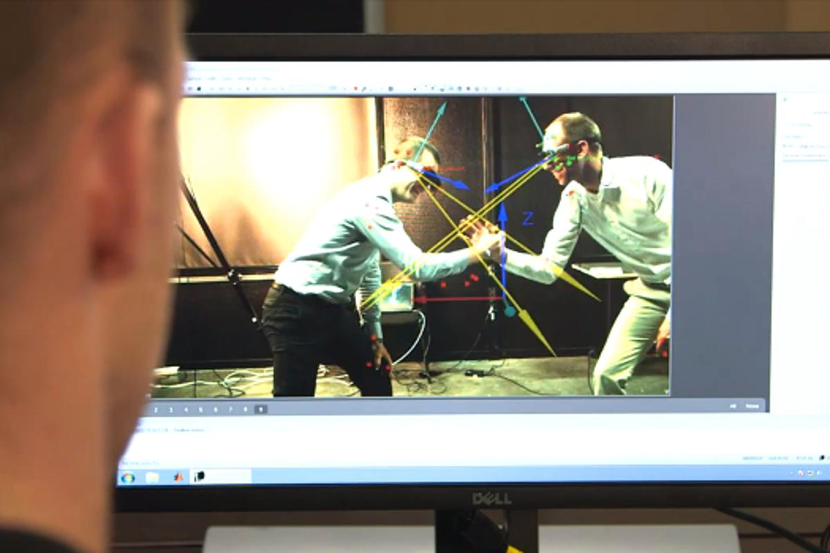 The setup incorporates eye-tracking glasses and a motion capture system