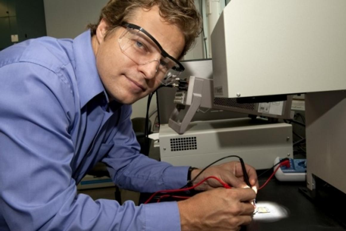 Chemical engineering Professor Brian Korgel tests one of his printed solar cells